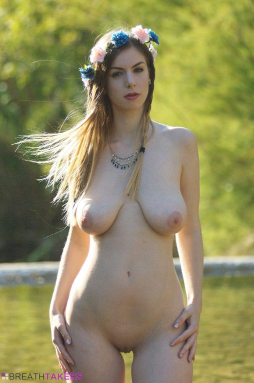 Large breasts nude girl in the river with flowers in her hair
